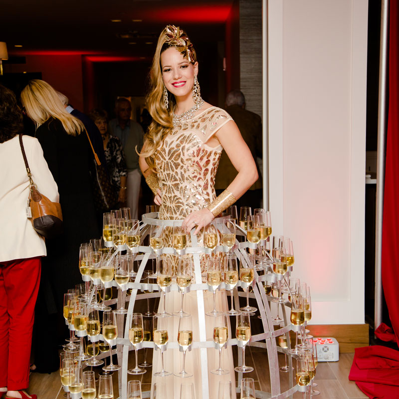woman with champagne dress at grand opening