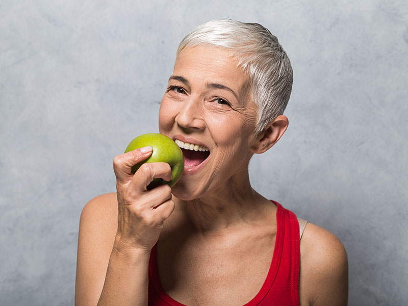 Woman biting into an apple