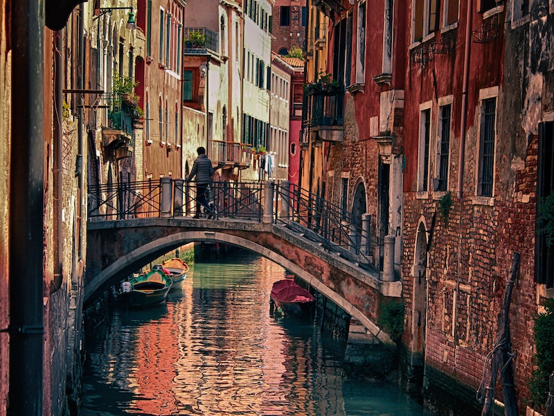 canal in italy with gondolas