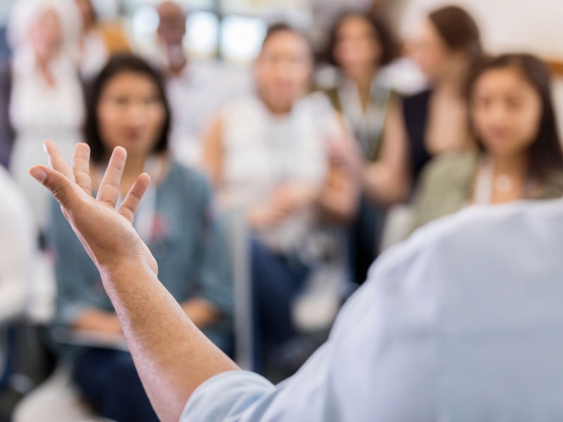 man speaking to an audience