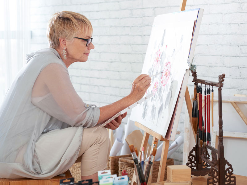 woman painting on an easel