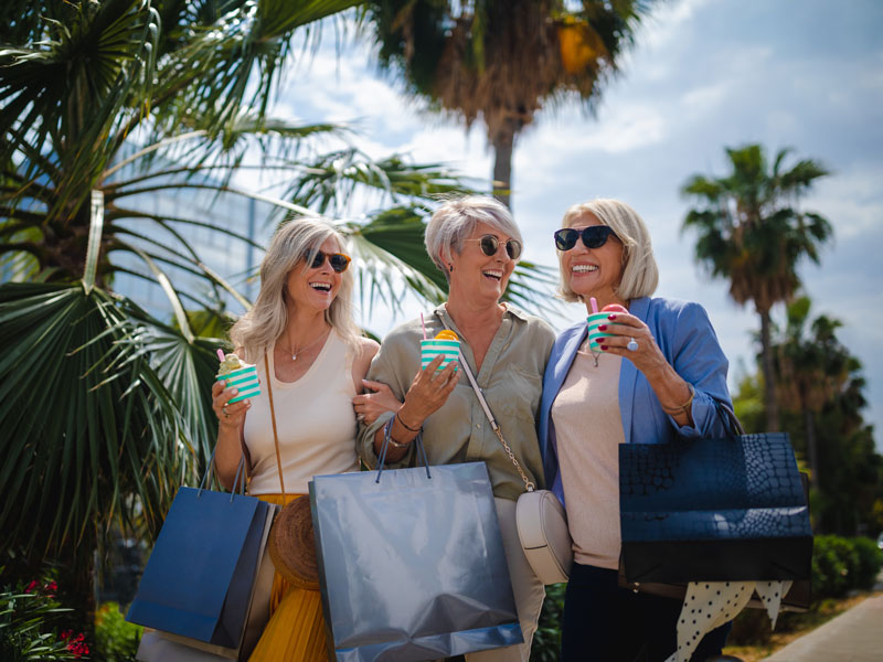 three senior women shopping