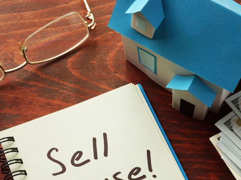 Sell Your Home written on a note pad