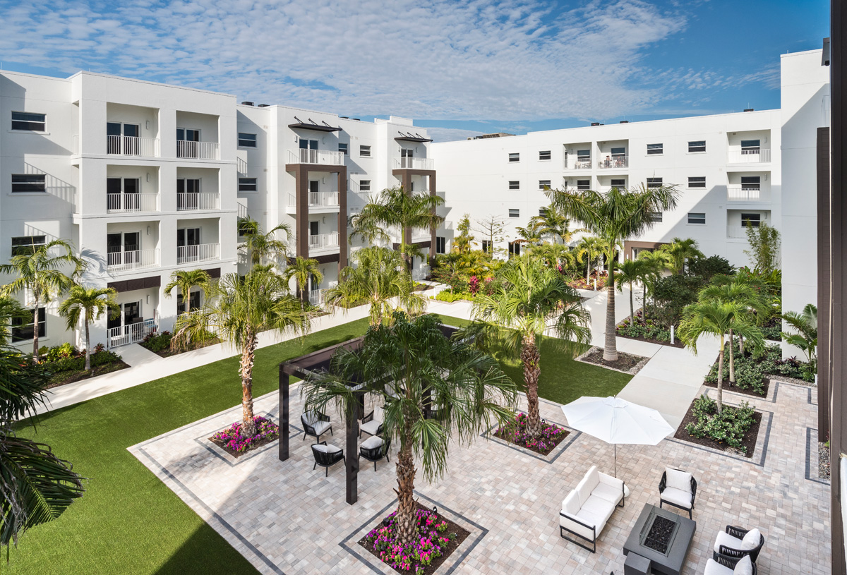 Waters Edges garden courtyard hosts a fire pit and seating areas throughout.