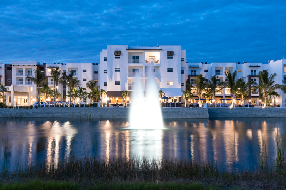 Night time view of our signature fountain in front our our casual dining restaurant Lakeside Grill.