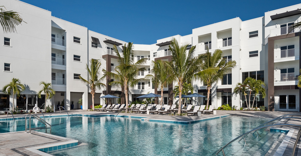 Waters Edge Resort Pool by Lakeside Grill offers a zero entry option as well as water fitness equipement for resident wellness.